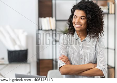 A Young Pleasant Brunette African American Mixed-race Woman With Afro Hairstyle Wearing A Casual Shi
