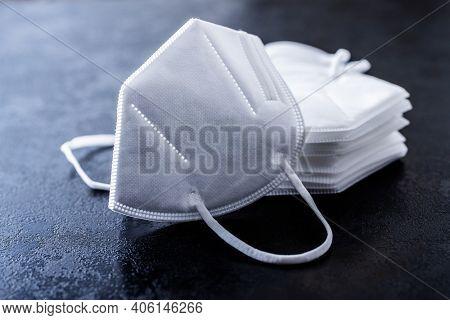 KN95 face mask. FFP2 mask as covid-19 protection. Coronavirus mask on black table.