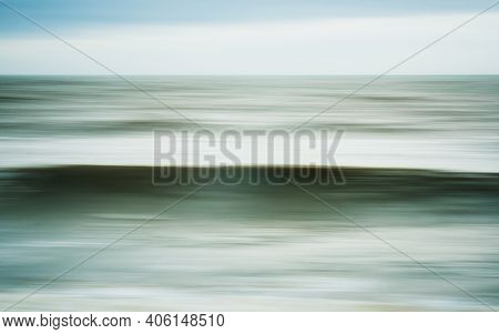 Intentional camera movement of ocean wave, dreamy seascape