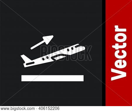 White Plane Takeoff Icon Isolated On Black Background. Airplane Transport Symbol. Vector