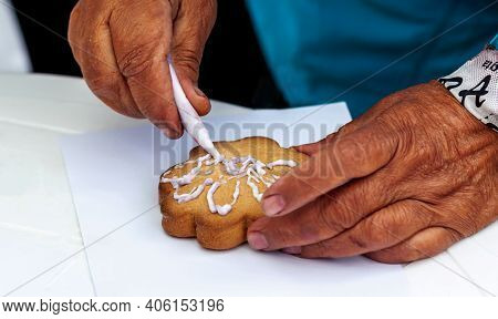 Perm Krai, Russia, July 2019. An Elderly Woman In A Blue Jacket With Her Left Hand Holds Cookies On