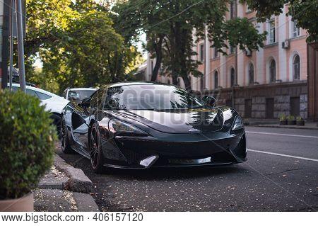 Odessa, Ukraine - August 2020. Supercar Mclaren 570s In A Black Color.