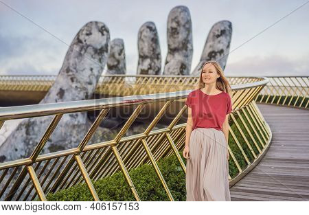 Young Woman Tourist At Famous Tourist Attraction - Golden Bridge At The Top Of The Ba Na Hills, Viet
