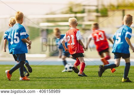 Young Footballers Kicking Football Match.football Soccer Players Running With Ball. Soccer Players R