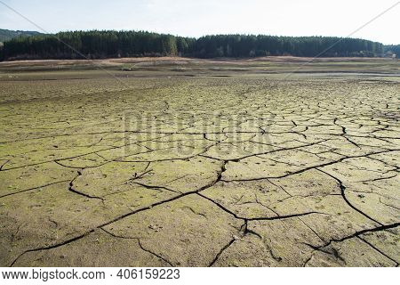 The Drought Bottom Of The An Empty Dam In Bulgaria. Hot Weather And Climate Changes Makes The Dam Al