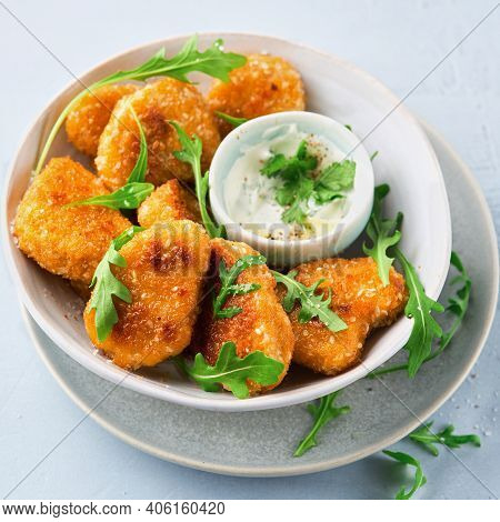 Close-up Vegetarian Nuggets, Vegan Dipping Sauce And Rocket Leaves On A Light Background, Space For