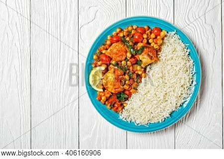 Chicken And Chickpea Curry And Jasmine Rice With Cherry Tomatoes, Spinach, Yellow Curry Paste Served
