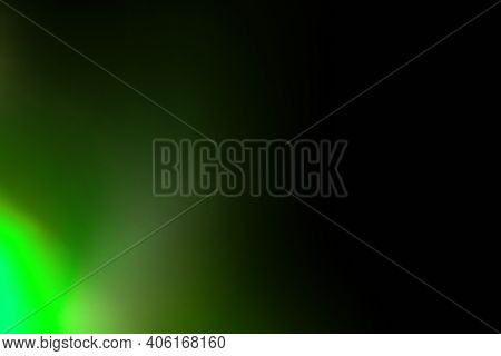 Colorful Abstract Background. Blur Glow. Defocused Radiance. Green Neon Light Rays On Black Decorati
