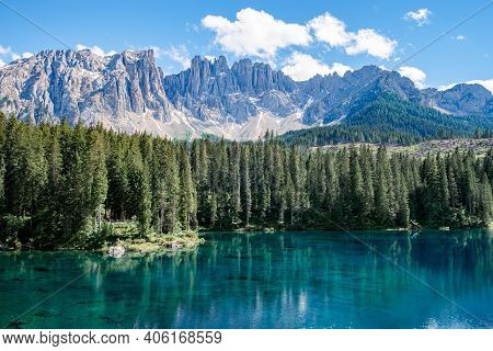 The Majestic Lake Of Lago Di Carezza, Beautiful Green And Turquoise Colors In Dolomites Mountains It
