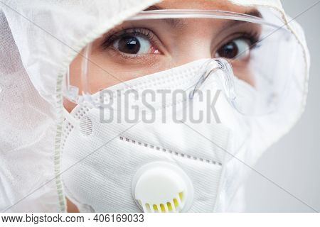 Female Uk Pharmacist Wearing Ppe Personal Protective Equipment,coveralls,face Mask,eyewear,glove,hol