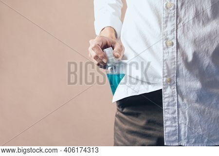 People Are Taking The Alcohol Spray From Their Pants Pocket, Copy Space.