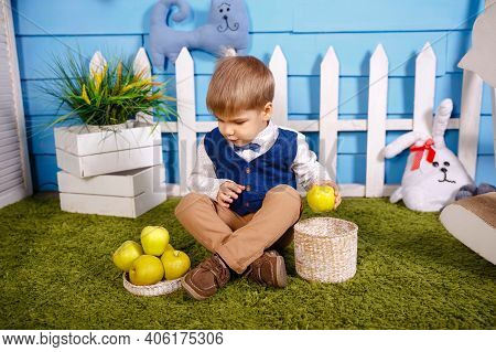 Happy Child On Farm Picking Apples In Orchard. Cute Funny Little Boy With Wicker Basket. Kid Is Gath