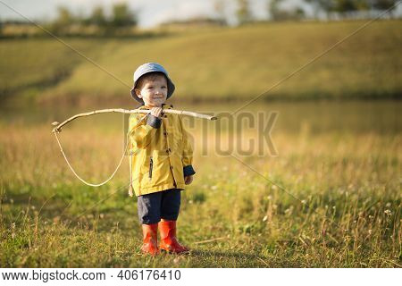 Child Boy Ready For Fishing. Cute Little Boy In Hat Holding Big Fishing Net At The Ready.