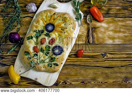 Italian Focaccia Flower, Flat Bread Decorated With Vegetables In The Form Of A Flower Pattern, Home