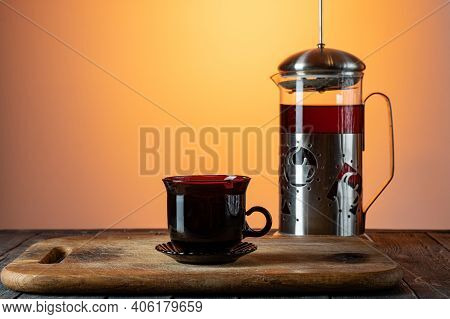 Glass Flask With Tea. Tea Mug And Teapot. Tea On The Kitchen Board. Teapot And Mug.