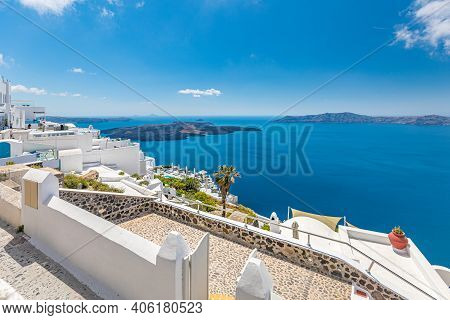 Scenic View Of Aegean Sea At Santorini, Greece. Traditional Famous White Blue Houses Wih Flowers Und