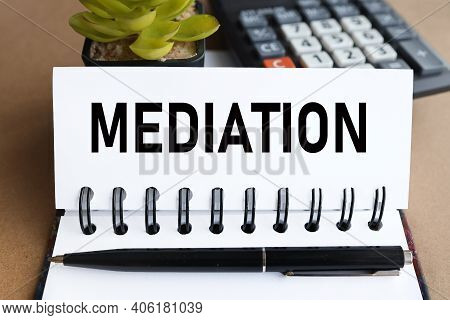 Mediation, Text On White Notepad Paper Near Calculator