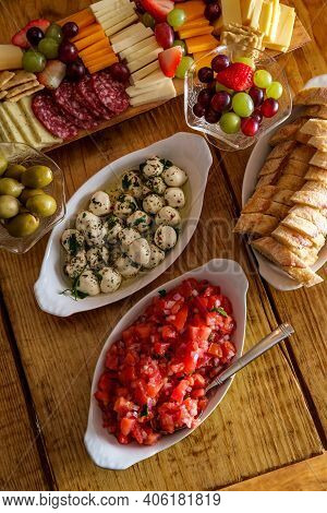 Hors D'oeuvres Appetizer Spread With Charcuterie Board Bruschetta Crusty Bread And Bocconcini Mozzar