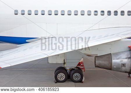 Engine On White Fuselage With Portholes Of Passenger Plane, Jet Turbine, Windows, Wing, Aircraft Det