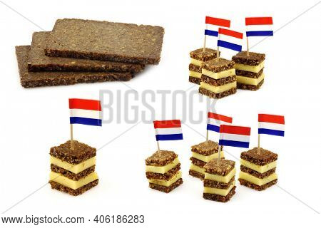 traditional layered rye bread and cheese snacks with Dutch  flag toothpick and some pieces of rye bread on a white background