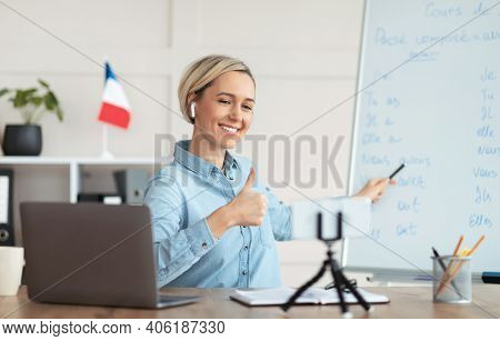 Online French Lesson. Foreign Languages Tutor Teaching Class On Webcam, Talking To Students, Showing