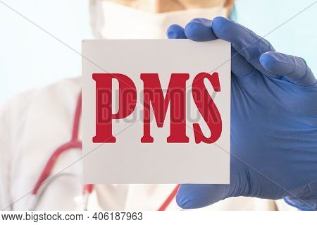 Female Doctor In Blue Latex Gloves Holding A Tablet With The Text: Pms