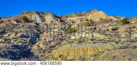 Geological Stony-clay Landscape, Mountains And Rocks In The Evening At Sunset. North Dakota