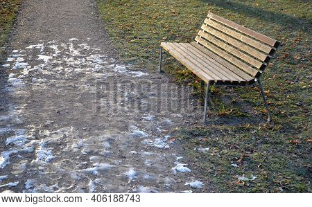 Frozen Paths In The Park Do Not Tempt You To Walk. There Is A Risk Of Fractures And Injuries. Winter