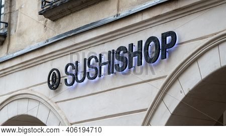 BAYONNE, FRANCE - CIRCA DECEMBER 2020: Sushi Shop sign. Sushi Shop is a French chain of Japanese fast food restaurants.