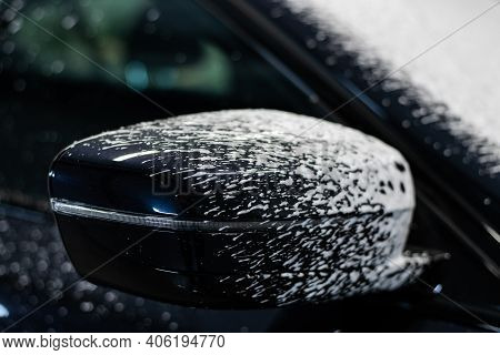 Cleaning Car With White Snow Foam Shampoo. Spraying White Snow Foam On A Car. Spraying Car Shampoo F