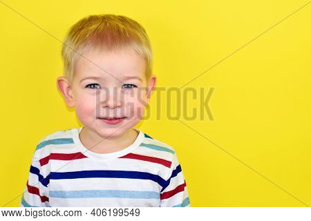 Happy Smiling Little Boy On Color Background. Portrait Of A Beautiful European Boy Two Years Old On