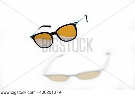 Conceptual Elegant Sunglasses Hovering Isolated On White Background. Sun Glasses Summer Accessories