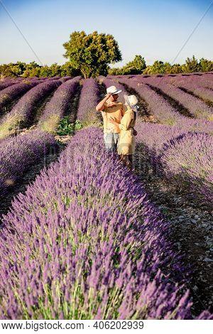 Lavender Fields In Ardeche In Southeast France. Europe, Couple Walking In Lavender Fields, Men And W
