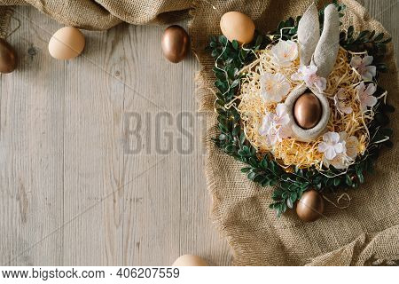 Easter Eggs And And Green Wreath. Congratulatory Easter Background. .