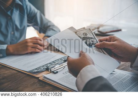Businessman Was Negotiating An Agreement In Which The Dollar Was Accepted As A Bribe In Corruption.