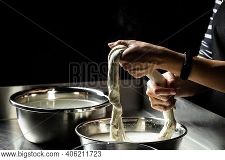 Woman Preparing Tasty Cheese On Dark Background Cheese Production Process, Homemade Cheese Producer,