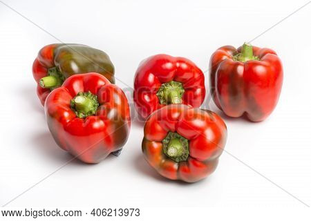 A Group Of Bulgarian Sweet Peppers On A White Background, With Shadows. Studio Photo, Isolate, Peppe