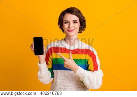 Photo Of Pretty Girl Hold Smartphone Indicate Finger Touchscreen Empty Space Wear Striped Sweater Is