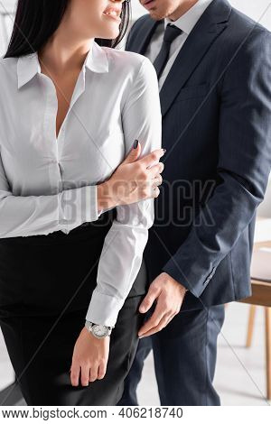 Partial View Of Sexy Secretary Seducing Businessman In Office.