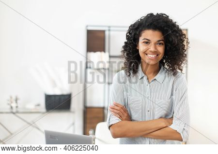 Young Pleasant Brunette African American Mixed-race Woman With Afro Hairstyle Wearing A Casual Shirt