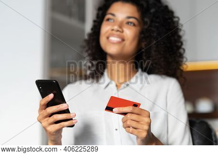 Blurred Image Of An African American Teenage Girl Dreaming About Future Purchase, Spending Money Fro