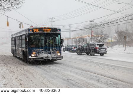 NORWALK, CT, USA-FEBRUARY 1, 2021:  CT Transit transportation bus  during snow storm  day on Connecticut Ave.