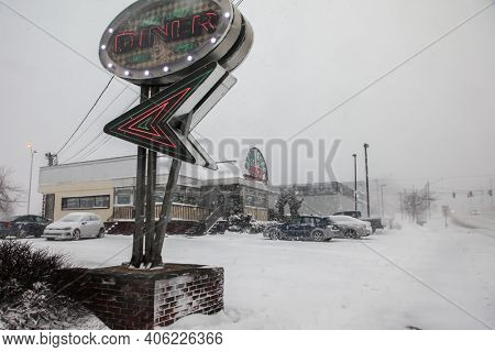 NORWALk, CT, USA-FEBRUARY 1, 2021:  Post Road Diner restaurant near Connecticut Avenue during snow storm  day