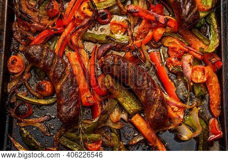 Broiled Sausage Onions And Peppers With Cherry Tomatoes And Thyme