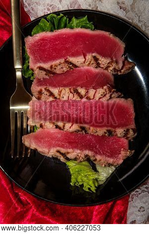 Seared Ahi Tuna With Grill Marks Sliced To Reveal Tender Pink Raw Inside