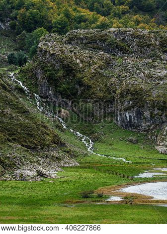 River Flows To Fence In Lagos De Covadonga