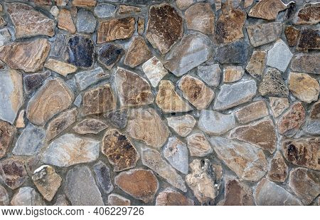 Natural Stone Cladding In Rustic Style. Stone Wall Texture. Old Castle Stone Wall Texture Backgroun