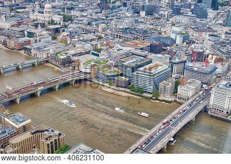 London Aerial View With River Thames Bridges: Southwark Bridge, Cannon Street Railway Bridge And Lon