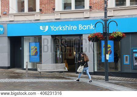 Leeds, Uk - July 11, 2016: People Walk By Yorkshire Bank In Leeds, Uk. Yorkshire Bank Is A Trading N
