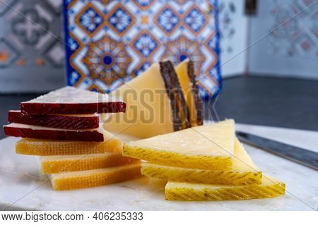 Spanish Snacks Tapas, Variety Of Sliced Goat, Sheep, Manchego Cheeses, Served In Andalusian Interior